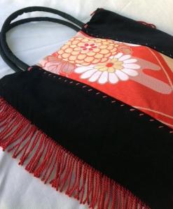 Velvet and silk handbag featuring sexy side tassles