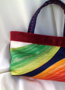 Gorgeous mini handbag featuring rainbow Japanese obi and kimono silk lining